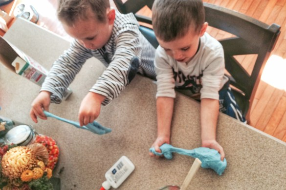 Charlie and Dom playing with gak