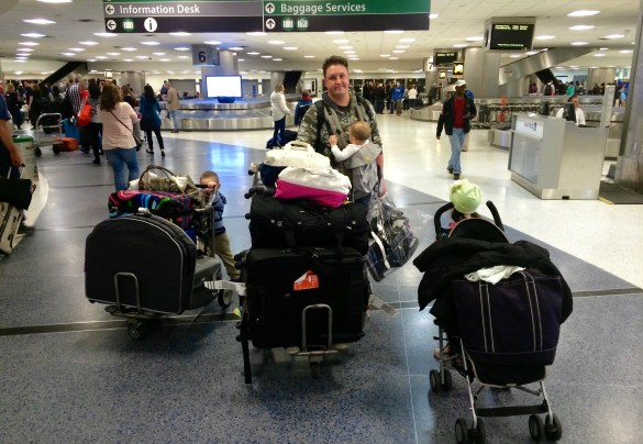 Adrian in Texas airport with luggage
