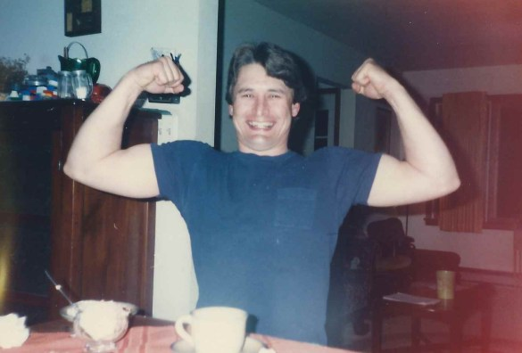 Dad flexing after dinner