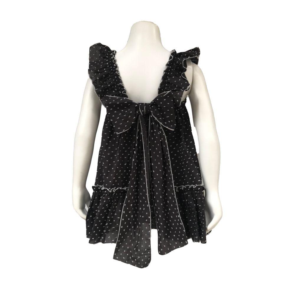 Espalda Manuela Montero vestido negro