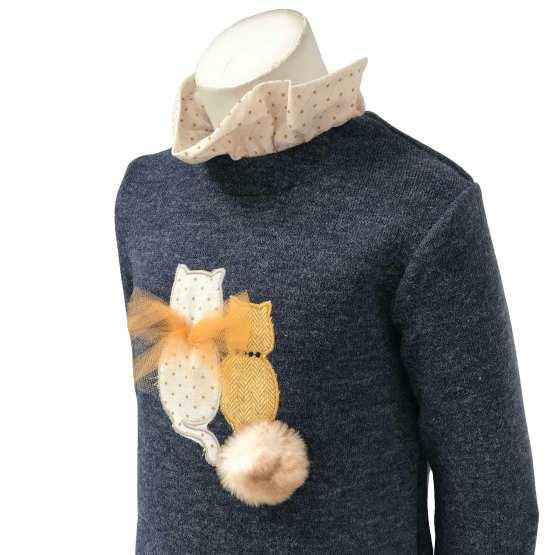 Detalle Coco Acqua vestido gatos volantes en espalda