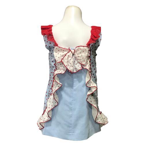 Espalda Dolce Petit vestido azul con topos y lazos rojos
