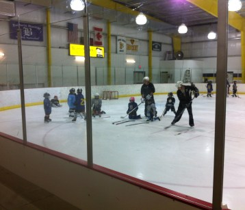 The youth hockey team practice foot work
