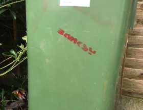 banksy tag on rubbish bin