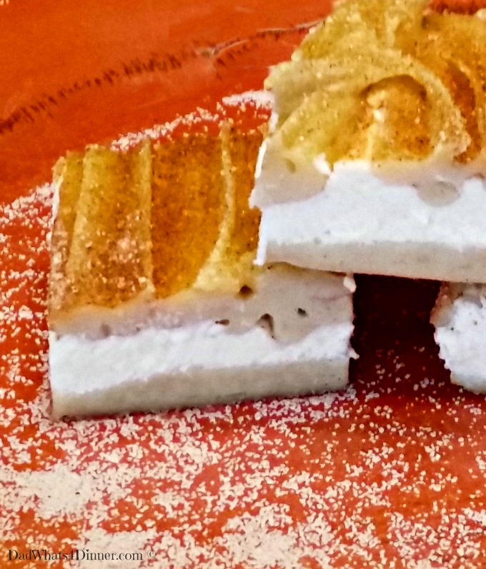"My Churro Cheesecake Bars takes a festival favorite ""churro's"" and turns it into a scrumptious cookie bar with a cheesecake filling."