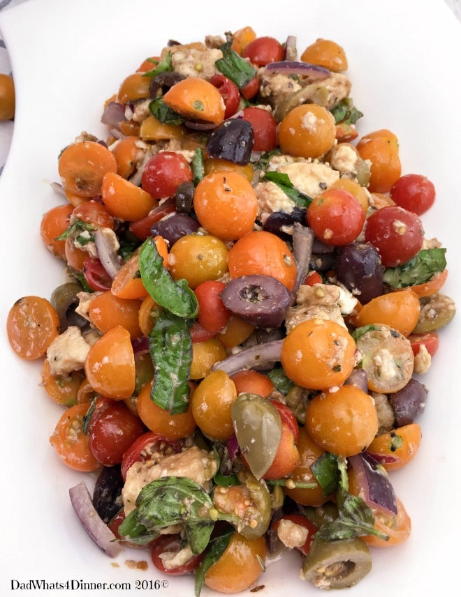 Cherry tomatoes, pitted olives, marinated fresh mozzarella and basil make this marinated Tomato Olive Salad super fresh and full of summer flavors.