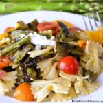 If you love pasta salad you will be blown away with my Grilled Asparagus Pasta Salad for #BBQWeek. Veggies grilled to perfection with a tangy basil and roasted garlic vinaigrette. #BBQWee