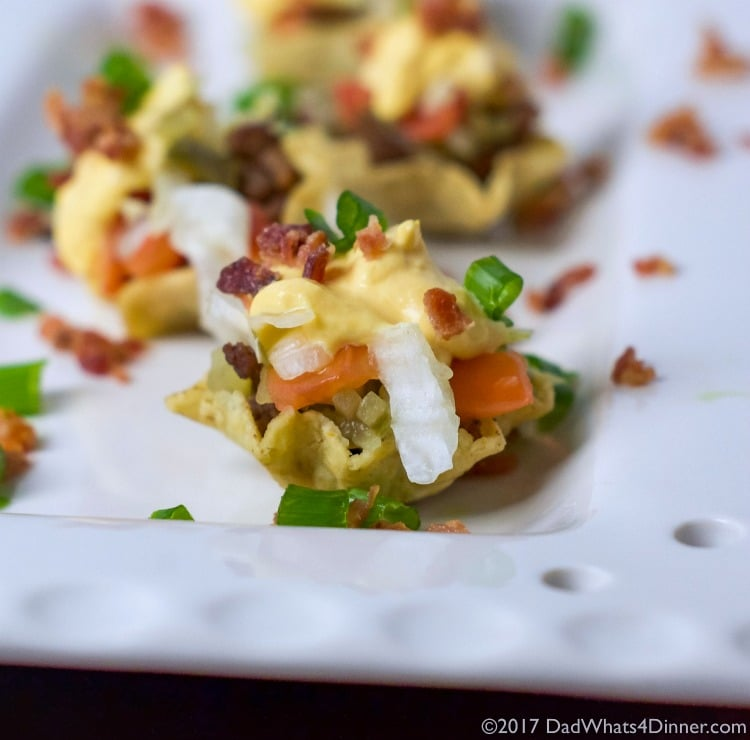 When you are craving the flavors of a cheeseburger but want finger foods instead then my Mini Cheddar Bacon CheeseburgerNachos is sure to please. The perfect appetizer forthe Big Game.