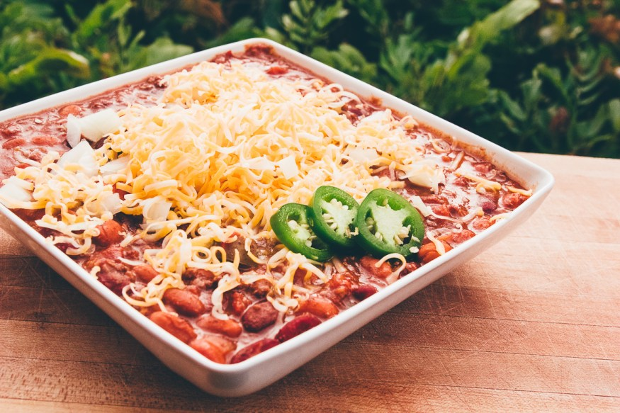 Slow cooked Crock Pot Chili with Ground beef tomatoes, beans and jalapenos and a spicy seasoning, This batch of spicy chili is a great weeknight dinner!