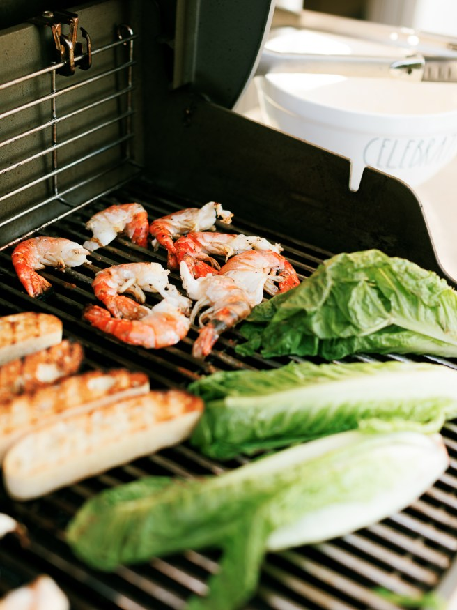 Grilled shrimp, grilled romaine lettuce, and grilled ciabatta bread. for a Caesar salad