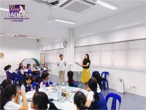 Teacher Hara and Jun with CHIJ St. Nicholas Girls' school students completed their Basic Korean workshop