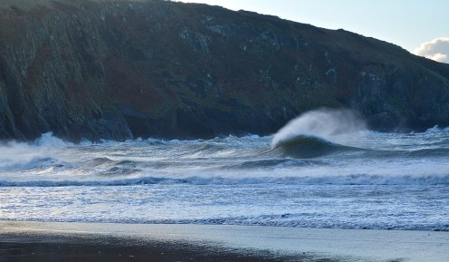 action photography of a breaking wave at Mwnt beach, Wales