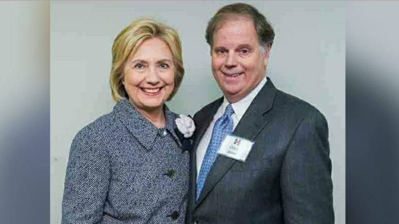 (Feature Photo credit to screen capture and Dagger News, Doug Jones and Hillary Clinton)