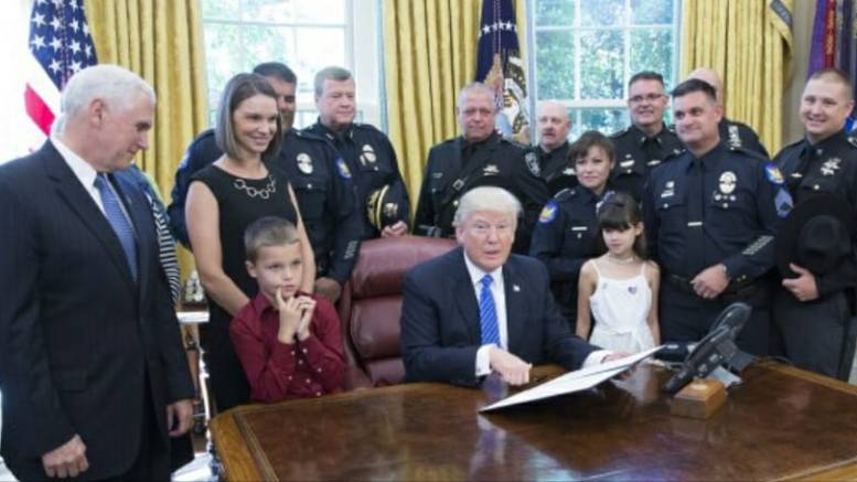 Feature Photo credit EPA. US President Donald J. Trump signs a proclamation supporting police officers at The White House in Washington, DC, USA, 15 May 2017.