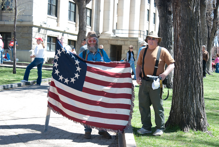 """Gary Talking with Man Holding """"Besty Ross"""" Flag"""