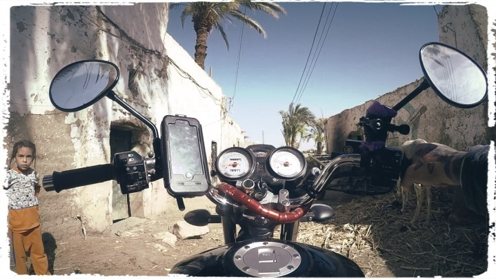 cruising through small villages is favourite past time of mine, motorcycle egypt, luxor temple, egypt, wanderlust, dagsvstheworld, rtw trip, luxor, nile
