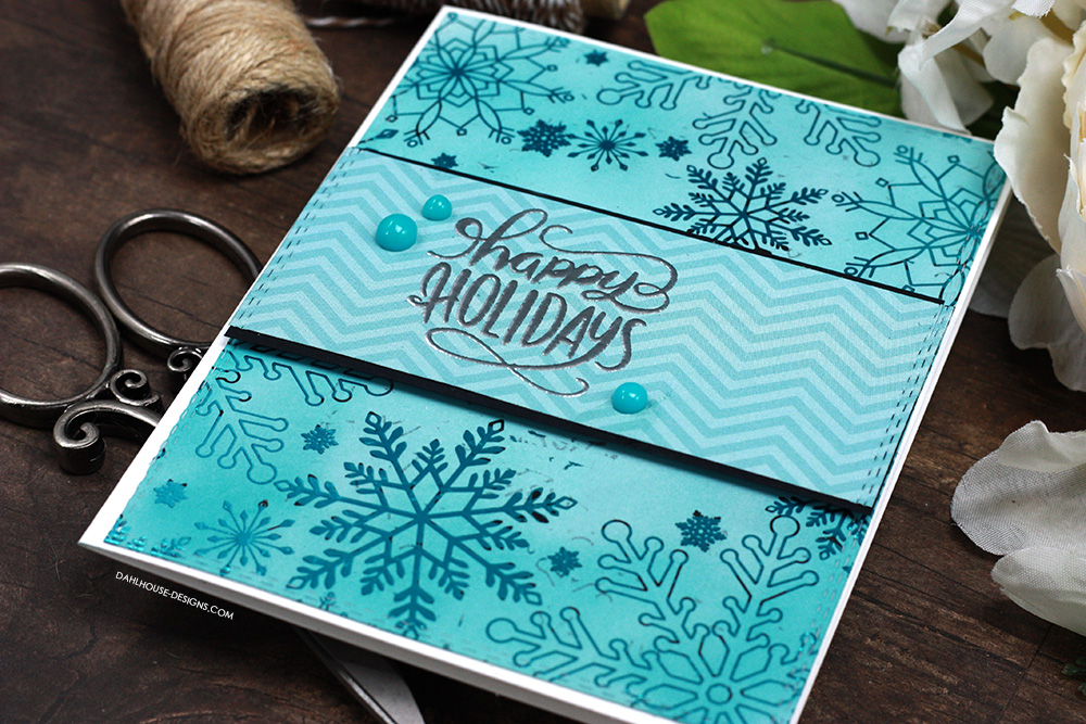 Sharing a fun Holiday card idea using toner sheets and foil. The images are from the Snow Many Flakes toner sheet and Glimmering Greetings Unity Stamp Company stamp set. More inspiration on dahlhouse-designs.com. #cardmaking #cardmaker #cardmakingideas #cardinspiration #simplecards #stamping #dahlhousedesigns #unitystampco #handmadecards #diecutting #carddesign #cardtechnique #thermoweb #foiling #christmascards