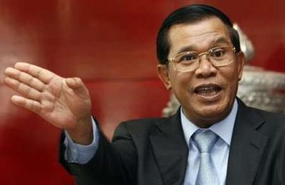 Cambodia's Prime Minister Hun Sen speaks to the media upon his arrival from Japan at Phnom Penh international airport November 8, 2009.