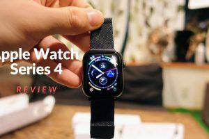 apple_watch_series4_spacegray_aluminum_40mmとサードパティのスペースグレイミラネーゼループバンドを手で持ち上げている様子