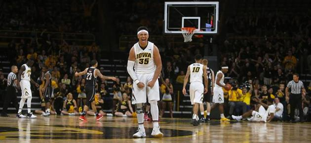 Iowa forward Cordell Pemsl celebrates after an Iowa made basket in the game between Nebraska-Omaha vs. Iowa at Carver Hawkeye on Saturday, December 3, 2016. The Hawkeyes comeback fell short, being defeated by the Mavericks  98-89. (The Daily Iowan/ Alex Kroeze)