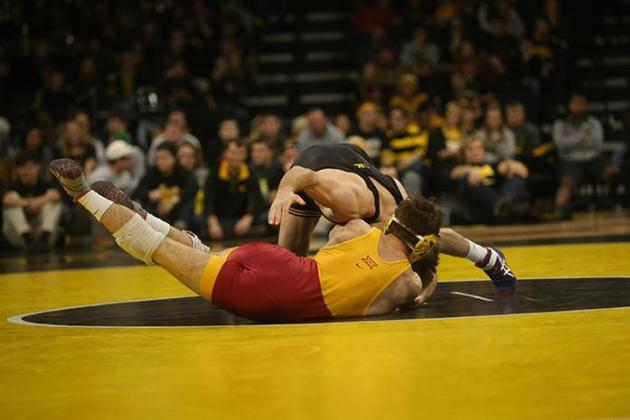 Iowa 149-pounder Brandon Sorensen wrestles Iowa State's Chase Straw during the Iowa-Iowa State match in Carver-Hawkeye Arena on Saturday, Dec. 10, 2016. Sorensen defeated Straw with 11-3 decision. Iowa defeated Iowa State, 26-9. (The Daily Iowan/Margaret Kispert)