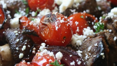 Beef Kabobs with blistered tomatoes and feta cheese.