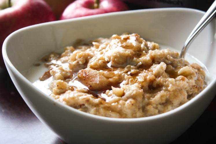 Crock Pot Oatmeal with Apples and Cinnamon with milk and maple syrup drizzled over the top is a warm and comforting breakfast.