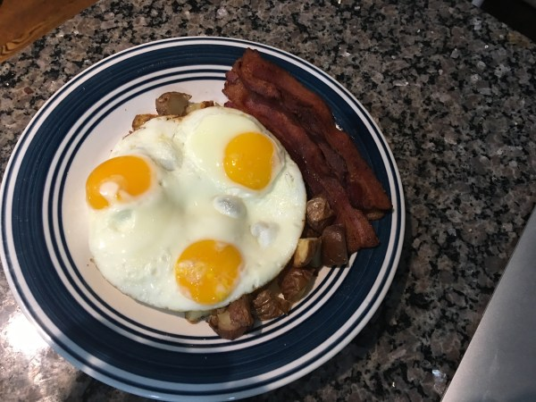 Crispy Potatoes served with Eggs & Bacon