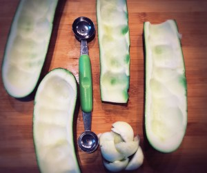A melon baller makes it easy to scoop out the centers of each zucchini half