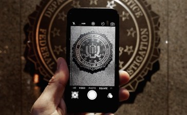 The official seal of the Federal Bureau of Investigation is seen on an iPhone's camera screen outside the J. Edgar Hoover headquarters February 23, 2016 in Washington, DC. Last week a federal judge ordered Apple to write software that would allow law enforcement agencies investigating the December 2, 2015 terrorist attack in San Bernardino, California, to hack into one of the attacker's iPhone. Apple is fighting the order, saying it would create a way for hackers, foreign governments, and other nefarious groups to invade its customers' privacy. Chip Somodevilla/Getty Images.