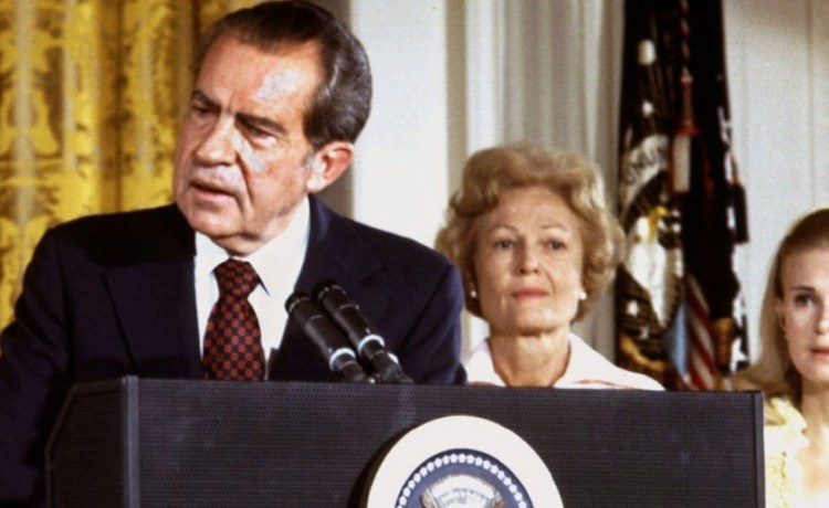"""President Richard Nixon (L), listened to by First lady Pat Nixon and daughter Tricia Nixon (R), says goodbye to family and staff in the White House East Room on August 9, 1974. On Monday it will be 25 years since Nixon resigned his office, or """"resigned in disgrace"""" as many of the news accounts would say, as it became clear the House of Representatives would impeach him for Watergate misdeeds and the Senate would follow by convicting him. In the quarter century since that day, historians, politicians and Nixon himself until he died on April 22, 1994, have argued his legacy and how his resignation -- the first by an American president -- changed the highest office in the land. - Reuters"""