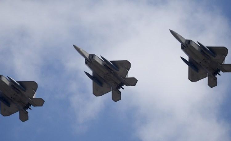 U.S. F-22 stealth fighter jets fly over Osan Air Base in Pyeongtaek, South Korea, February 17, 2016. REUTERS/Kim Hong-Ji
