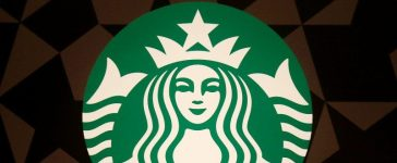 A Starbucks logo is pictured on the door of the Green Apron Delivery Service at the Empire State Building in the Manhattan borough of New York, U.S. June 1, 2016. REUTERS/Carlo Allegri