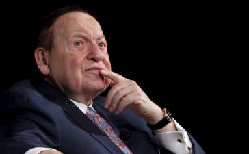 Gambling giant Las Vegas Sands Corp's Chief Executive Sheldon Adelson reacts during a news conference in Macau, China