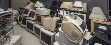 Piles of old computers in office building /Photo: Shutterstock
