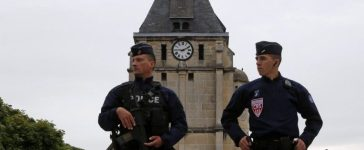 French CRS police stand guard in front of the church a day after a hostage-taking in Saint-Etienne-du-Rouvray near Rouen in Normandy, France, where French priest, Father Jacques Hamel, was killed with a knife and another hostage seriously wounded in an attack on the church that was carried out by assailants linked to Islamic State. REUTERS/Pascal Rossignol