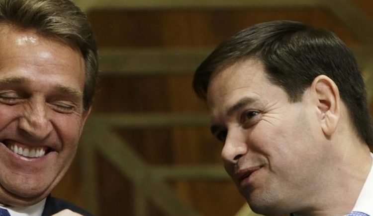 U.S. Senator Marco Rubio (R-FL) laughs with fellow subcommittee member Senator Jeff Flake (R-AZ) (L) at the Senate Foreign Relations' Western Hemisphere Subcommittee hearing on President Barack Obama's changes to Cuba policy in Washington February 3, 2015. REUTERS/Gary Cameron (UNITED STATES - Tags: POLITICS) - RTR4O39D
