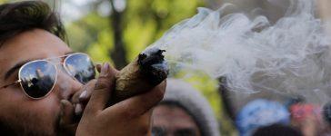 A man smokes marijuana during a rally for the legalization of marijuana in Mexico City, Mexico, May 7, 2016. REUTERS/Henry Romero