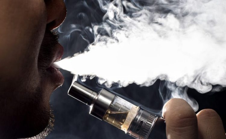 A vaper exhales a puff. Copyright: Rommel Canlas/Shutterstock.com