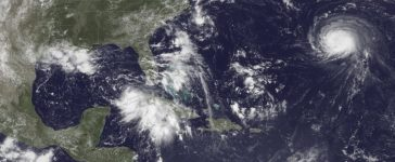 Handout photo of satellite image of three storm systems shown in the Atlantic Ocean