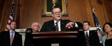 WASHINGTON, DC - OCTOBER 09: U.S. Sen. Jon Tester (D-MT) looks to his watch while speaking at a press conference highlighting how veterans are being impacted by the government shutdown with (L-R) Sen. Richard Blumenthal (D-CT), Sen. Bernie Sanders (I-VT), Sen. Mark Begich (D-AK), and Sen. Mazie Hirono (D-HI) at the U.S. Capitol October 9, 2013 in Washington, DC. During the event, Tester and others discussed how critical veterans services are being affected by the shutdown. (Photo by Win McNamee/Getty Images)