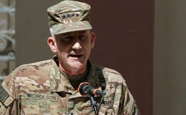 Nicholson speaks during a memorial ceremony to commemorate the 15th anniversary of the 9/11 attacks, in Kabul