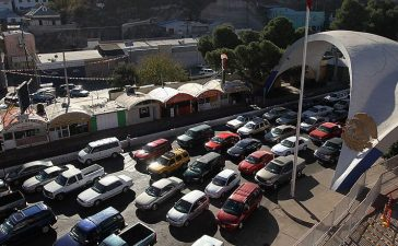 "NOGALES, AZ - DECEMBER 10: Hundreds of cars wait to pass from Mexico into the United States at the border crossing on December 10, 2010 in Nogales, Arizona. Despite Arizona's tough immigration enforcement laws, thousands of Mexican citizens have permits to work in the U.S. and commute daily from their homes across the border in Mexico. Border crossings, known as ""ports of entry,"" are run by the U.S. Office of Field Operations, which is part of the department of U.S. Customs and Border Protection. Port personnel are the face at the border for most visitors and cargo entering the United States and are authorized to stop, question, search and examine everyone entering the country. (Photo by John Moore/Getty Images)"