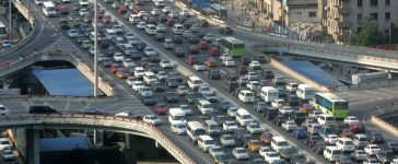 A traffic jam is seen during the rush hour in Beijing June 14, 2006. China needs to improve public transport to help curb choking traffic jams instead of building more and more highways to make room for private cars, the World Bank said on Wednesday. REUTERS/ Jason Lee