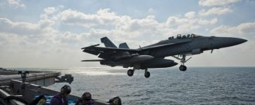 An F/A-18F fighter jet launches off the aircraft carrier USS John C. Stennis during maneuvers in the Arabian Gulf in this U.S. Navy handout photo dated November 23, 2011. REUTERS/U.S. Navy/Benjamin Crossley/Handout
