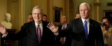 U.S. Vice President-elect Mike Pence (R) and Senate Majority Leader Mitch McConnell (R-KY) wave as they walk before their meeting on Capitol Hill in Washington, U.S., November 30, 2016. REUTERS/Yuri Gripas -