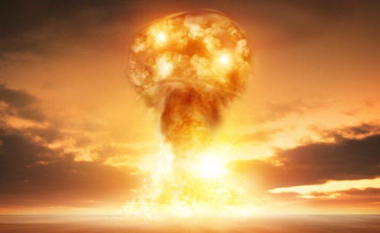 A modern nuclear bomb explosion in the desert. (Shutterstock.com/solarseven)