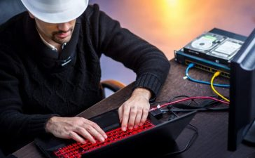 """Computer user """"trolling"""" other people on the internet. [Shutterstock - napocska]"""