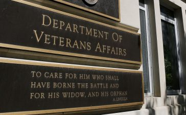 The sign of the Department of Veteran Affairs is seen in front of the headquarters building in Washington, May 23, 2014. REUTERS/Larry Downing.