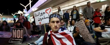 Demonstrators shut down the traffic loops at LAX International Airport and yell slogans during a protest against the travel ban imposed by U.S. President Donald Trump's executive order, at Los Angeles International Airport in Los Angeles, California, U.S., January 29, 2017. REUTERS/Ted Soqui